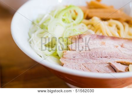Pork And Onion Sliceed On Noodle In Red Bowl