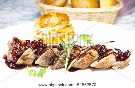 meat with cranberry sauce