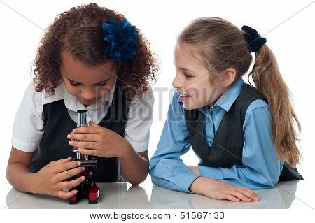 Two Pretty School Girls With Microscope