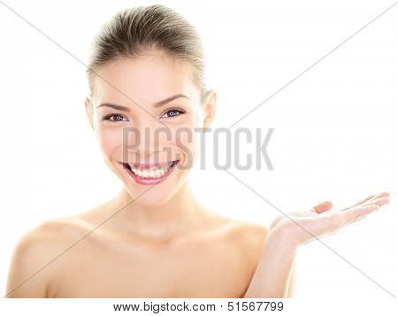 Body skincare care beauty Asian woman showing product on side with open hand. Healthy glowing skin on multi-ethnic Chinese / Caucasian girl presenting and displaying isolated on white background.
