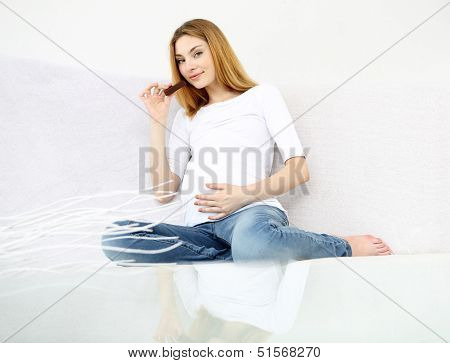 Pregnant woman on the white background.