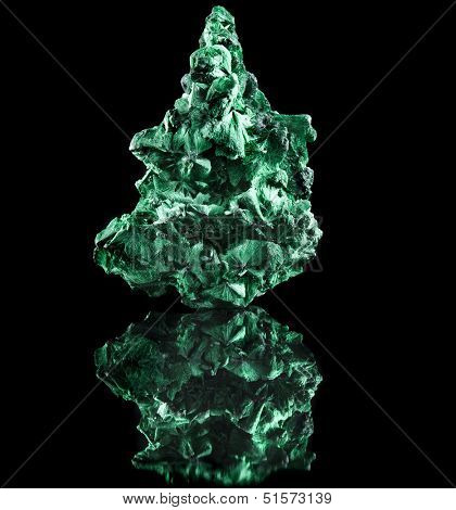 malachite mineral stone close up  with reflection on black surface background