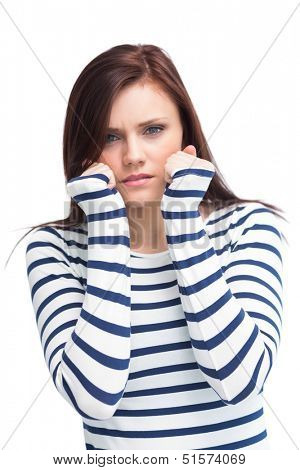 Fearful young brunette posing on white background