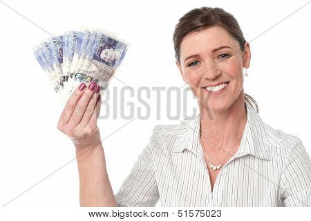 Businesswoman Holding Fan Of Currency Notes