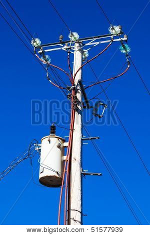 post with electrical wires in the sky