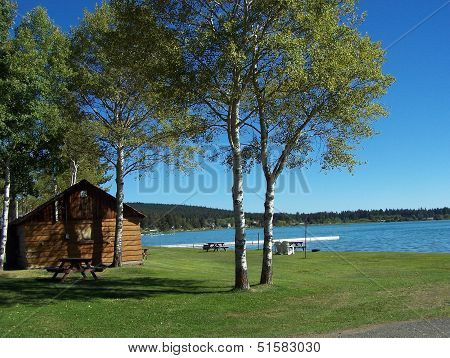 Cabin by the lake in Autumn