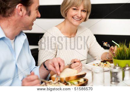 Couple Enjoying Vegetarian And Healthy Breakfast