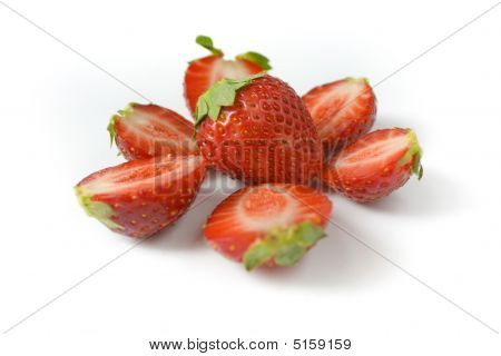 Whole Strawberry And The Berries Of A Strawberry Cut On Halves