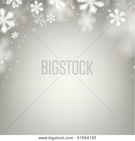 Winter background. Fallen defocused snowflakes. Christmas. Vector.