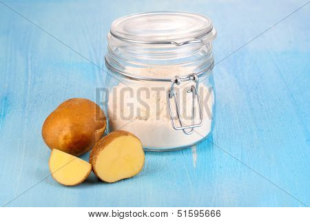 Starch in bank on wooden table close-up