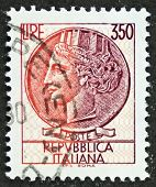 ITALY - CIRCA 1977: a stamp printed in Italy shows  head of Italia Turrita (Italy with towers), nati