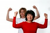 picture of lifting weight  - two women in exercise mode - JPG
