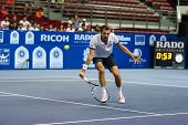 KUALA LUMPUR - SEPTEMBER 27: Julien Benneteau volleys a return to Adrian Mannarino in a semi-final m