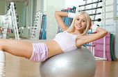 picture of execution  - happy cutie athletic girl execute exercise on muscles belly and smile in sport - JPG