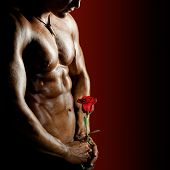 picture of sexuality  - the very muscular handsome sexy guy on black background naked torso - JPG