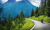 Motorcyclists in mountainous touring, extreme adventure, European journey, extreme road along Alps,