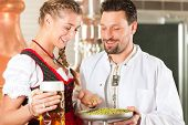 foto of stein  - Woman in Tracht and brewer with beer stein and hops in her brewery - JPG