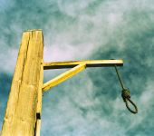 stock photo of gallows  - Rope with a knot attached to the gallows - JPG