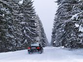 stock photo of sleet  - Road During Snowfall in Tatra Mountains in Poland - JPG