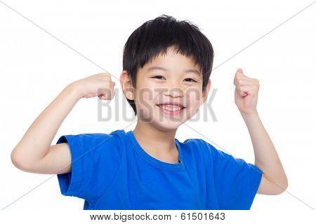 Asia little boy flexing biceps
