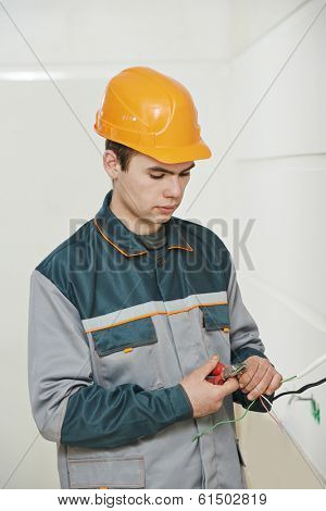 electrician worker in uniform working with cable wiring
