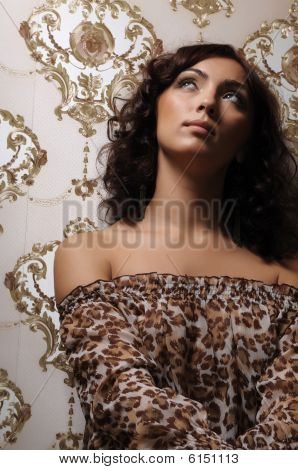Brunette Against Victorian Wallpaper