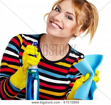 Spring cleaning woman ready for spring cleaning smiling with rubber gloves and cleaning products.