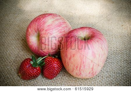 Strawberries And Light Red Apple