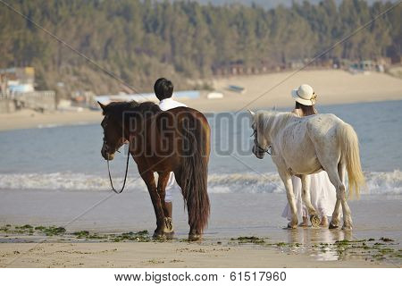 A Couple Walking On Beach