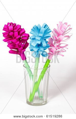 Bouquet Of Colored Paper Flowers In The Faceted Glass