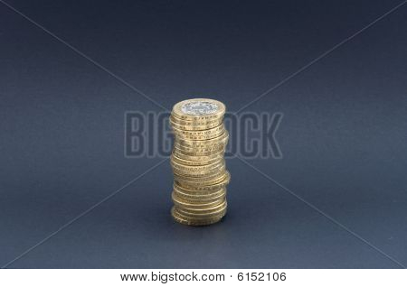 Tower of Coins isolated on grey