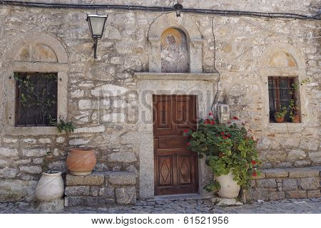 church entrance and flowerpots