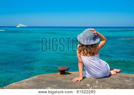Girl looking at beach in Formentera turquoise Mediterranean sea background
