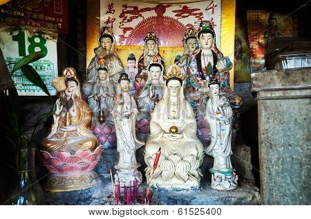 Statues Of The Goddess Of Mercy Guanyin In A Makeshift Shrine, Hong Kong