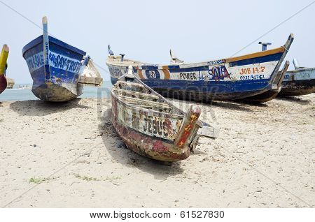 Old Broken Fishing Boats On The African Sea Sand
