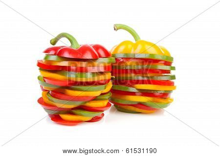 Two Paprika Made Out Of Colorful Slices
