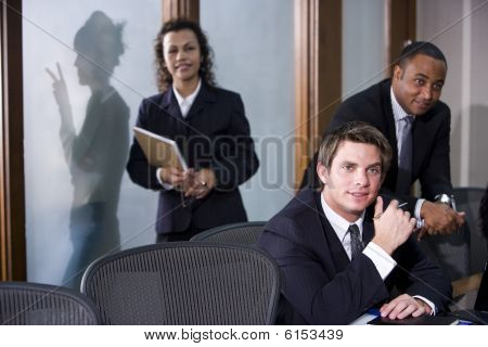 Multi-ethnic business executives in boardroom meeting