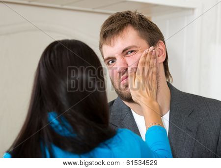 Upset woman slap her partner