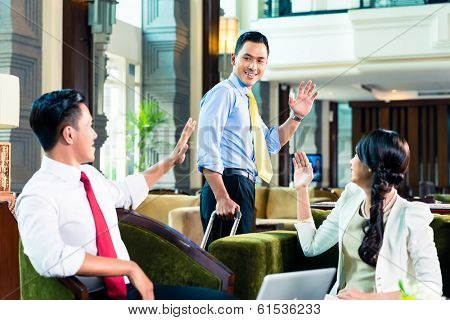 Businesspeople saying goodbye in a hotel