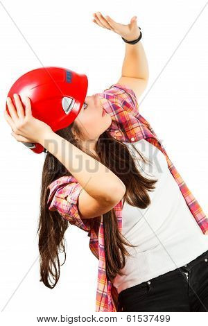 a girl in a red helmet with dread looks up