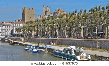 The Archbishops Palace from the Canal de la Robine, Narbonne, France.