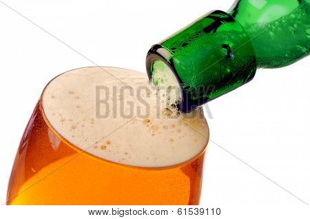 Pouring beer into glass with white background