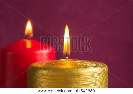 Gold And Red Candles On A Claret Background