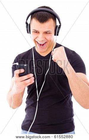 Man Listening Playlist On Mobile Phone Wearing Headphones