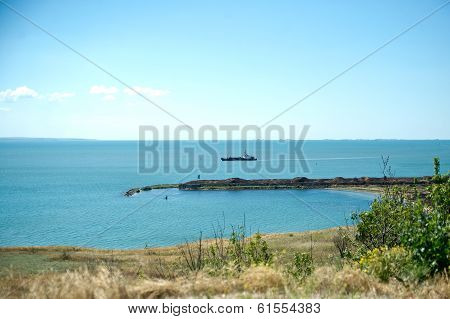 Black sea coast in Crimea, ship and fortress