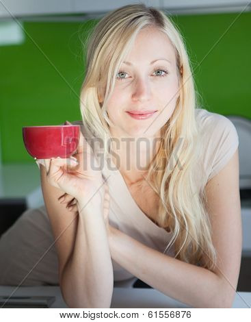 Woman Has Coffee Break At Home