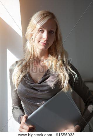 Woman With Laptop Near Window