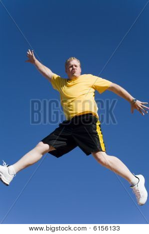 Man Jumping In Mid Air