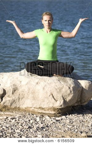 Yoga Woman Sitting Palm Up By Water