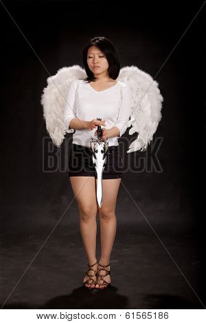 Girl angel with wings and sword